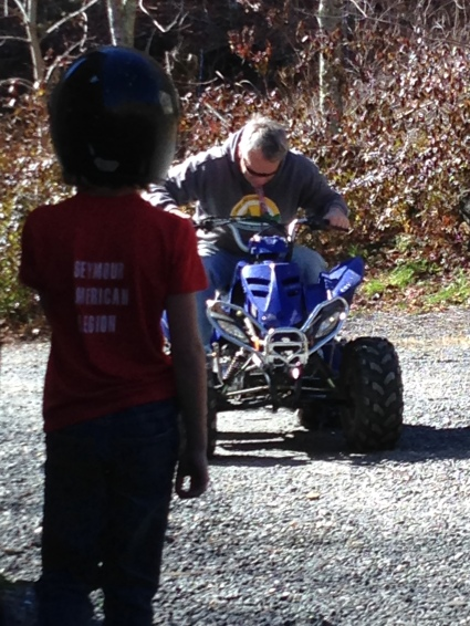 Ummm... This happened... (My father on a child's ATV)