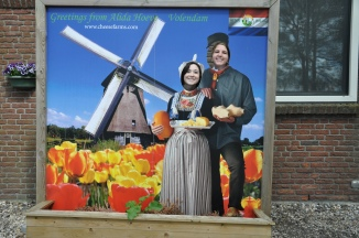 After frustration, aching feet, and a few miles of walking around, we finally found a cheese factory, so we posed.