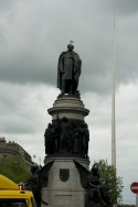 Daniel O' Connell Statue with the Spire of Dublin in the background.