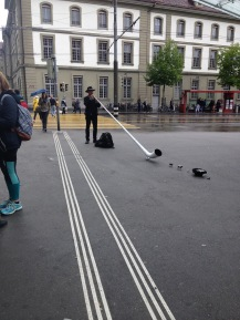 A man playing the alphorn. He even had little animals set out in front of it. So cute.